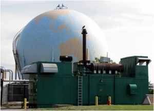 Image of the Woodward Wastewater Treatment Plant's BioGas storage sphere and cogeneration unit